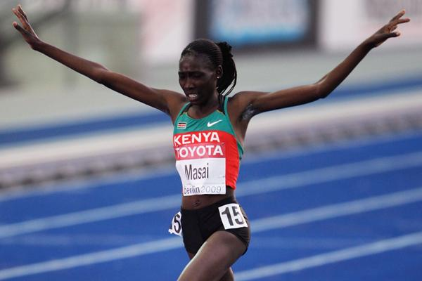 Kenya's Linet Chepkwemoi Masai crosses the line to end the 12 year Ethiopian domiance of the women's 10,000m (Getty Images)