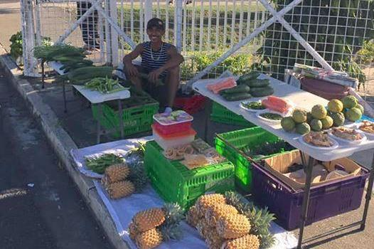 Fijian cross country runner Avikash Lal at his family's fruit stand (Avikash Lal)