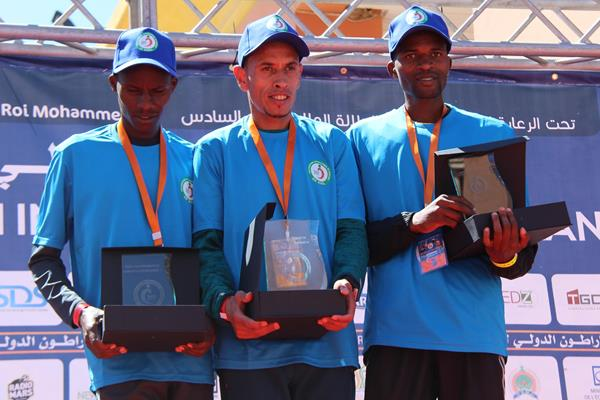 Berkane half marathon podium: winner El Hassan El Abbassi (c), runner-up Patrick Mwikya Mutunga (l) and third place finisher Kennedy Murithi Njiru (r) (organisers)