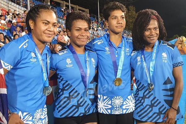 Heleina Young (second from right) and her 4x100m relay teammates at the 2019 Pacific Games (OAA)