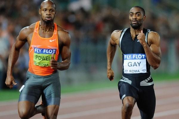 Tyson Gay holds off the challenge from Asafa Powell in the 100m (Getty Images)