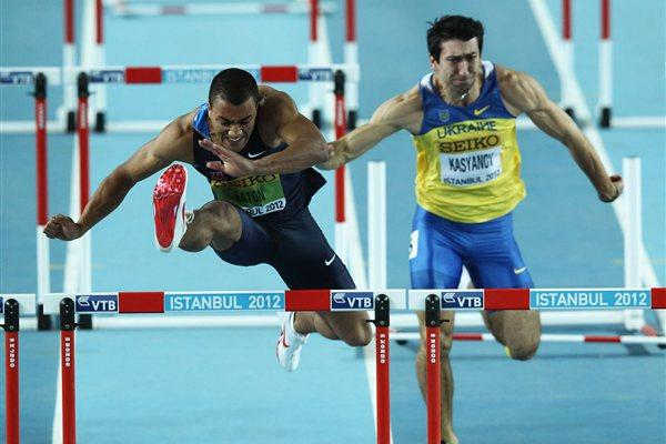 Ashton Eaton of the United States and Oleksiy Kasynov of Ukraine compete in the Men's 60 Metres Hurdles in the Heptathlon during day two - WIC Istanbul (Getty Images)