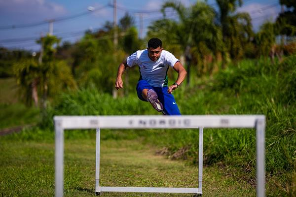 Brazilian hurdler Marcio Teles trains in a field near his home in Campinas (Getty Images)