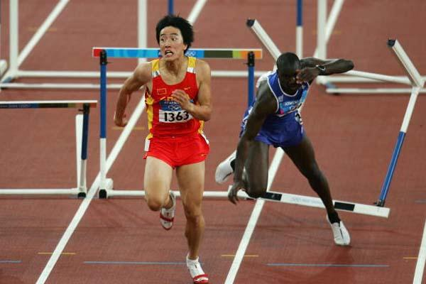 Xiang Liu of China on his way to winng the 110m hurdles gold (Getty Images)
