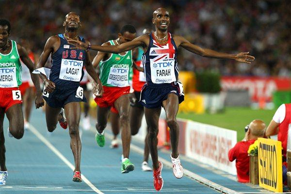Mohamed Farah of Great Britain celebrates as he crosses the finish line ahead of Bernard Lagat of the USA to claim victory in the men's 5000 metres final  (Getty Images)