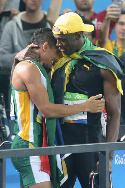 Usain Bolt congratulates Wayde van Niekerk after his world record (Getty Images)