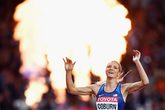 Emma Coburn crosses the finish line at the IAAF World Championships (Getty Images)