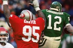 Michael Carter and Randall Cunningham ()