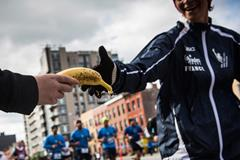 Runner receiving food at a marathon (Getty Images)