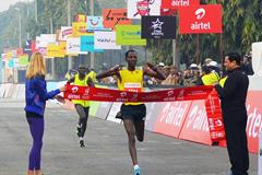 Adola runs course record 59:06 at Delhi Half Marathon| News | iaaf.org