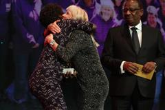 Cherry Alexander congratulated by Tegla Loroupe at the IAAF Athletics Awards (Giancarlo Colombo)