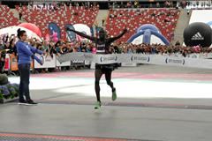 Ezekiel Omullo crosses the line to win the Warsaw Marathon (Organisers)