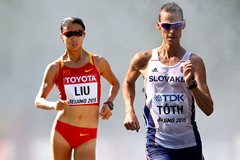 Liu Hong and Matej Toth (Getty Images)