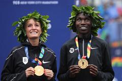 Shalane Flanagan and Geoffrey Kamworor after their victories in New York (Getty Images)