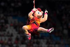 Hero flies into stadium on a zip wire (Getty Images)