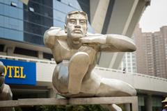 Hurdler sculpture at Shanghai Stadium (Bob Ramsak)