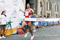Japan's Akira Aizawa wins the half marathon at the World University Games in Naples (FISU)