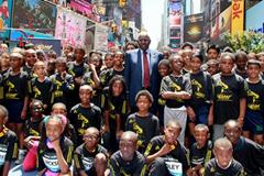 IAAF President Lamine Diack and 100 kids celebrate the IAAF Centenary in New York's  Times Square (Victah Sailer)