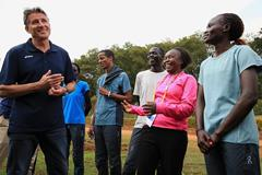 IAAF President Sebastian Coe with Tegla Loroupe and athletes from the refugee camp in Ngong (Getty Images)