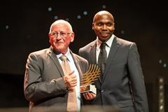 Coaching Achievement Award recipient Brother Colm O'Connell with Wilson Kipketer (Dan Vernon)