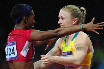Sally Pearson of Australia hugs Kellie Wells of the United States after winning the gold medal in the Women's 100m Hurdles Final on Day 11 of the London 2012 Olympic Games on 7 August 2012 (Getty Images)