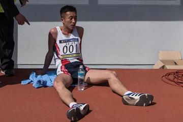 Pak Chol rests after winning the 2017 Pyongyang Marathon (AFP)