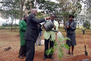 Edwin Moses does the watering following the tree planting at the Kenya International Conference Centre (IAAF.org)
