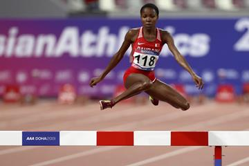 Winfred Mutile Yavi en route to the steeplechase title at the Asian Championships in Doha (AFP/Getty Images)