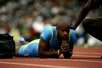 Asafa Powell of Jamaica lies down on the track injured in London (Getty Images)