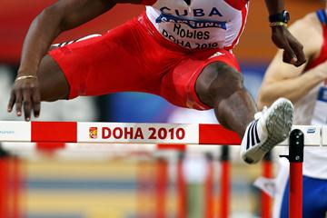 World record holder Dayron Robles of Cuba flies over a hurdle in the 60m hurdle heats in Doha (Getty Images)