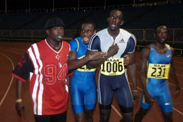 Brown and Burns centre of the picture, moments after their sub-10 race (Dexter Philip - Trinidad Express)