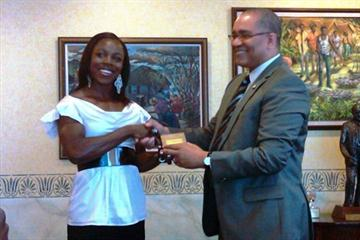 Veronica Campbell Brown presented with a gold coin recognising her efforts at the Beijing Olympics (Freelance)