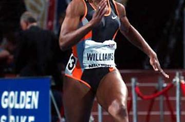 Angela Williams sprinting over 55m at  the 2003 LA Invitational (Kirby Lee)