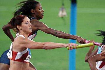 Natalya Ivanova of Russia hands over the baton in Athens (AFP/Getty Images)