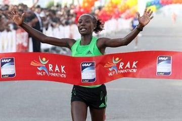 Mary Keitany smashing the Half Marathon World record in Ras Al Khaimah (Victah Sailer)