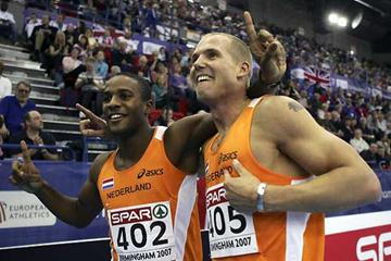 Gold medallist Gregory Sedoc of the Netherlands (L) celebrates with fellow countryman Marcel vand der Westen following the Men's 60 Metres Hurdles Final in Birmingham (Getty Images)