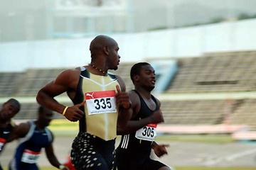 Asafa Powell wins his semi-final heat at the Jamaican Champs (Anthony Foster)