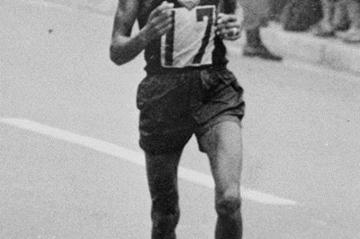 Abebe Bikila en route to his second Olympic Marathon title - Tokyo 1964 (Getty Images)