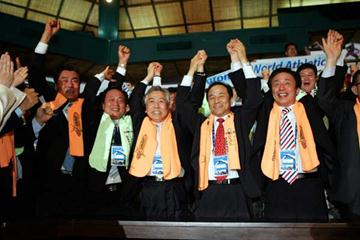 Led by Kim Bum-il, Mayor, Daegu Metropolitan city (extreme right) Koreans celebrate after Daegu is announced as the host to the IAAF World Championships in Athletics in 2011 (Getty Images)