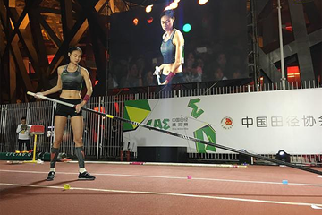 Li Ling competes at the street pole vault competition outside the Bird's Nest Stadium (Organisers)