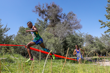 Daniel do Nascimento on his way to winning the junior men's race at the South American Cross Country Championships (Oscar Munoz Badilla)