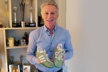 Eamonn Coghlan with the spikes he wore when setting a world indoor mile best of 3:52.6 in 1979 (Eamonn Coghlan)
