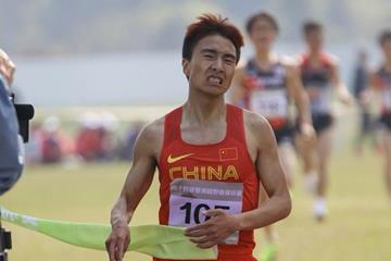 Peng Jianhua of China taking the Asian cross country title in Guiyang (Rahul Pawar/AAA)