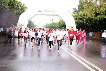 Rain didn't keep away thousands of runners at the 2011 Women's Race to Victory in Rabat (Organisers)