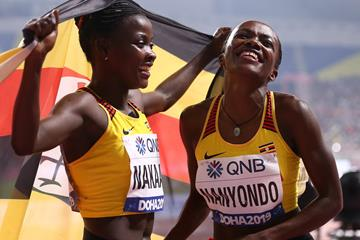 Halimah Nakaayi and Winnie Nanyondo celebrate after the women's 800m final in Doha (AFP/Getty Images)