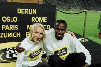 Gabriela Szabo and Wilson Kipketer celebrate in Berlin (© Allsport)