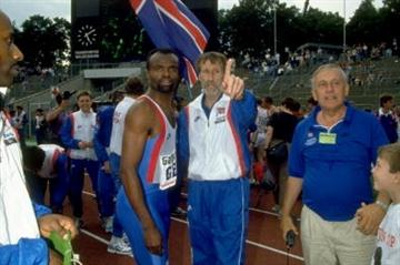 Team manager Les Jones (centre) celebrates with Tony Ward (right) and Kriss Akabusi (left) during the 1991 European Cup Finals in Frankfurt, Germany (Getty Images)