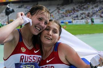 Nadezhda Leontyeva (R) of Russia, second, and the winner Ekaterina Medvedeva of Russia pose at the end of the Women's 10000 metres Race Walk on the day two of the 14th IAAF World Junior Championships in Barcelona on 11 July 2012 (Getty Images)