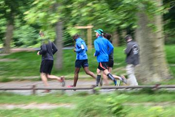 Runners jogging in the Bois de Boulogne park, after the mayor of Lille announced the reopening of some parks and gardens in the northern French city (AFP/Getty Images)