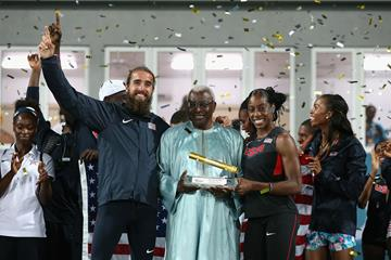 IAAF President Lamine Diack awards the Golden Baton to the USA, the overall best team at the inaugural IAAF World Relays (Getty Images)